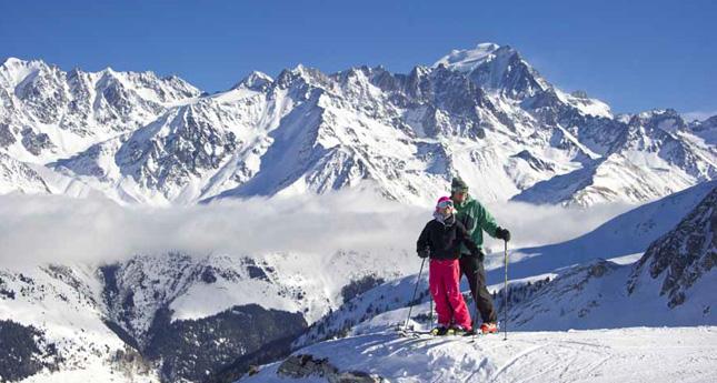 Skiers enjoy the view in the Verbier Saint-Bernard region.
