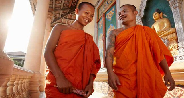 Two Buddhist monks at a temple