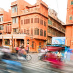 Cars and bicycles in motion on the street in Jaipur