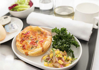Qantas Airways meal of tomato and mushroom puff pastry tart with corn salsa