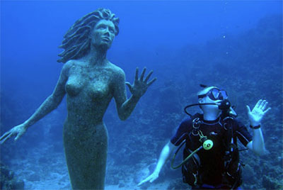 Mermaid statue and diver