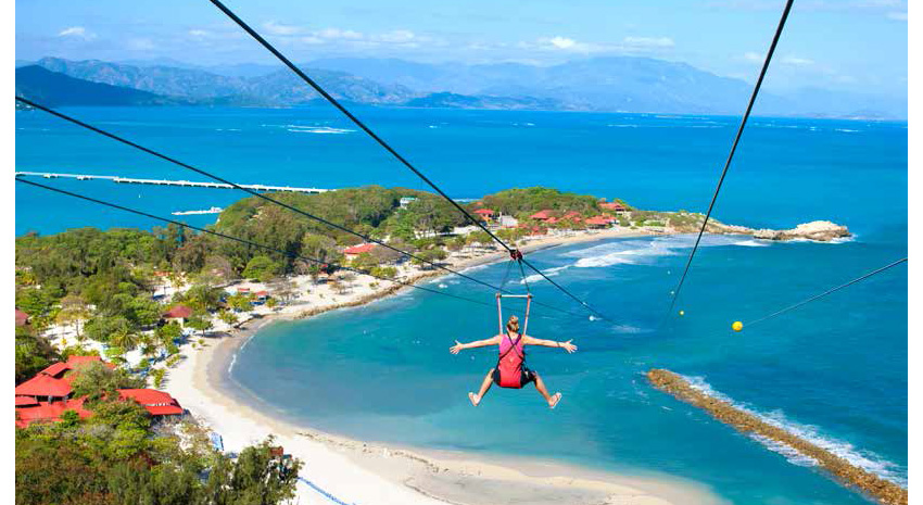 Royal Caribbean guests ride the world's longest overwater zipline on Labadee in Haiti