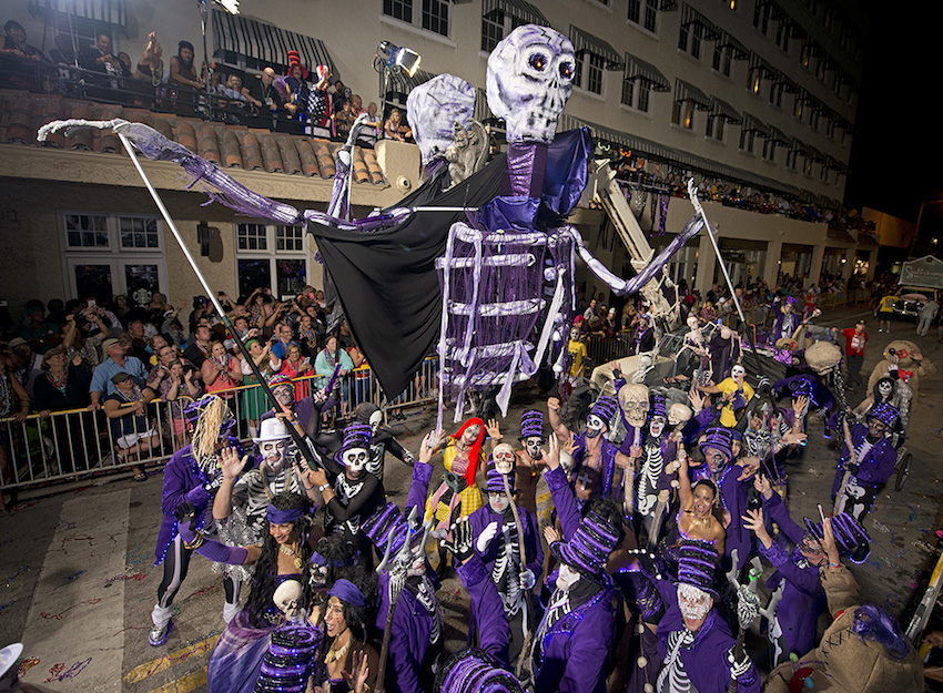"Revelers with ""The Purple Party"" proceed down Duval Street during the Fantasy Fest Parade Saturday, Oct. 29, 2016, in Key West, Fla. The event, that attracted more than 50,000 people, was the highlight of the island city's 10-day annual Fantasy Fest costuming and masking festival that concludes Sunday, Oct. 30. This year's theme was ""Political Voodoo and Ballot Box Barbarians."" (Andy Newman/Florida Keys News Bureau)"