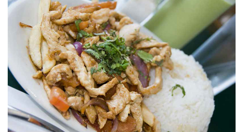 Pollo saltado, an authentic Peruvian dish of chicken, rice and herbs; and the national drink, pisco sour