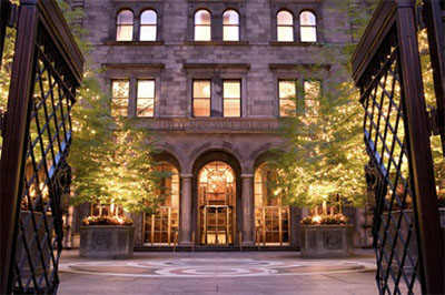 Lotte New York Palace hotel entrance at night