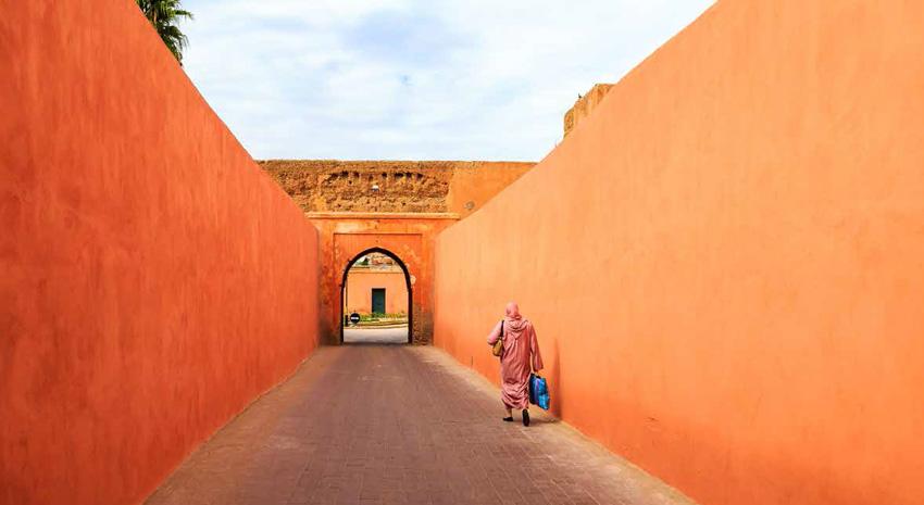 Muslim woman walking through a narrow street