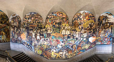 The stairs of the Palacio Nacional with the famous mural The History of Mexico by Diego Rivera
