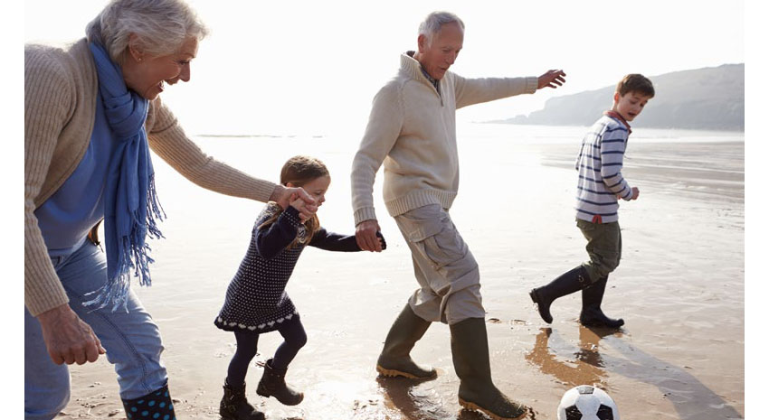 Grandparents enjoying vacation with their grandchildren