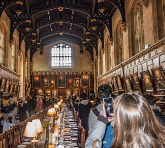 Tourists flock to the Great Hall of Christ Church College, University of Oxford, made famous in the Harry Potter movies