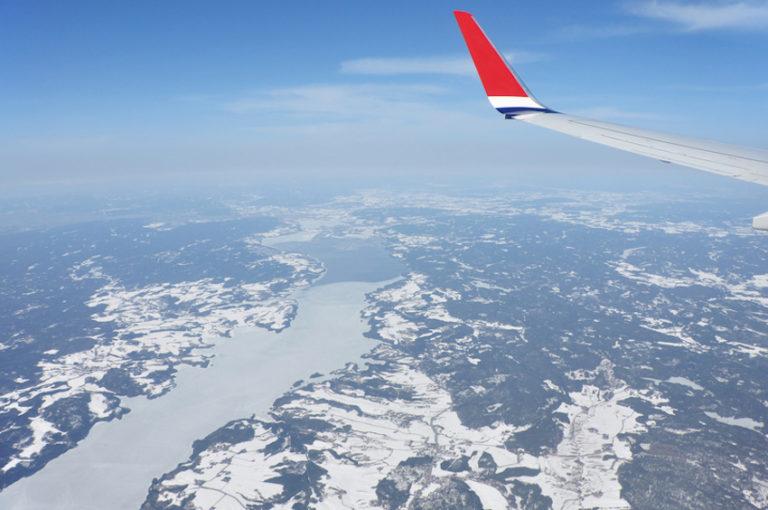Aircraft flying over Norwegian landscape © Krylkar | Dreamstime.com