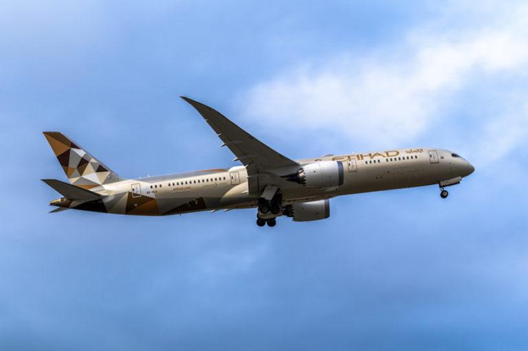 Etihad flying over Melbourne Airport © Sean Cooper | Dreamstime.com