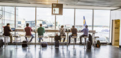 Travelers at the Airport in the evening in Frankfurt, Germany © Meinzahn | Dreamstime.com