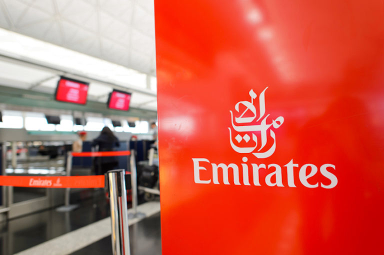 Emirates check-in area in Hong Kong Airport © Tea | Dreamstime.com
